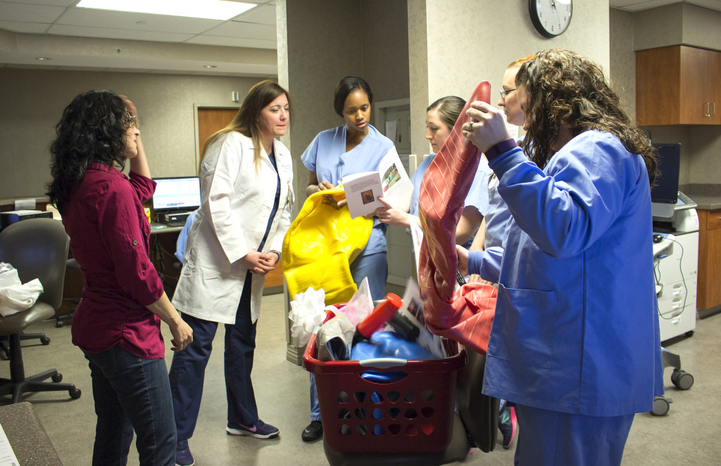 Nurses unpacking peanut ball gift basket